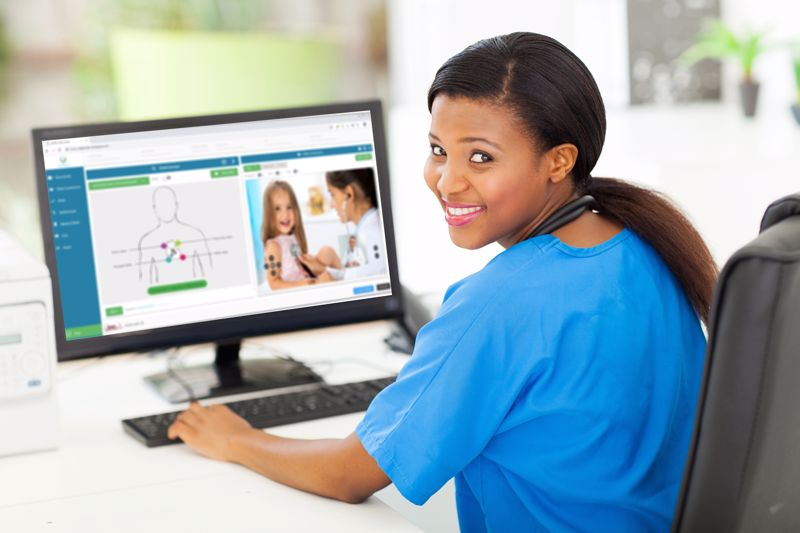 A health professional uses a computer.