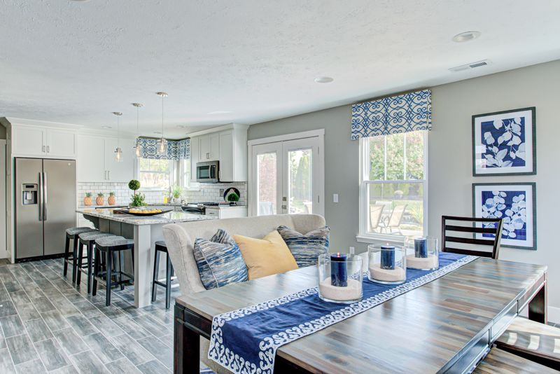 Use furniture to create division between rooms with an open floor plan.
