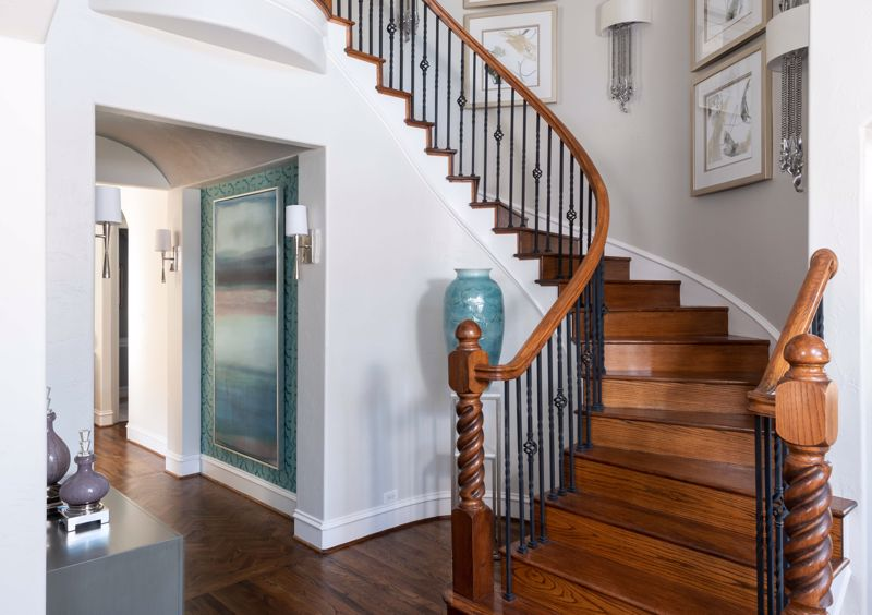 Decorate with artwork and accessories around the staircase.