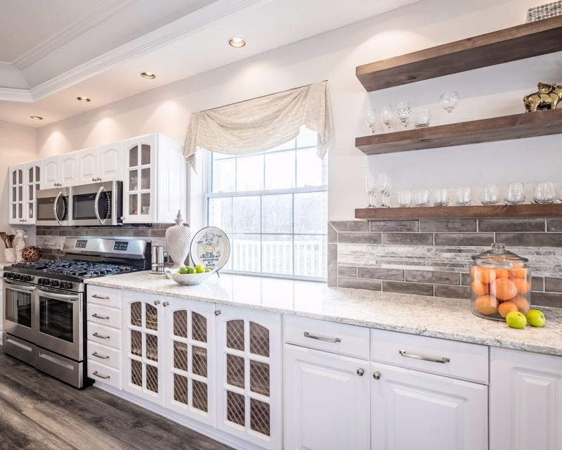 Make sure the items on the shelves match your kitchen theme.