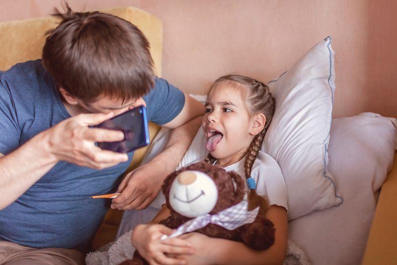A child receives a virtual check-up.