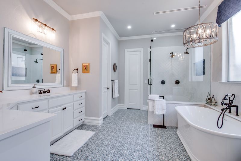 Small sconces make a big statement in the bathroom.