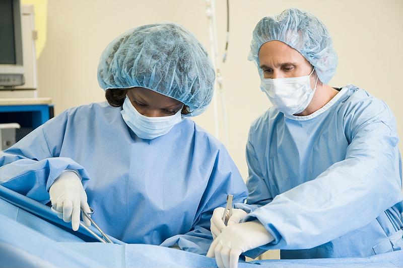 Surgeons treating a patient.